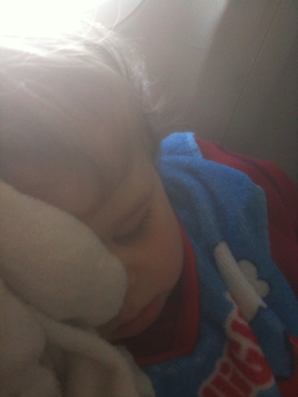 Alex sleeps on the plane