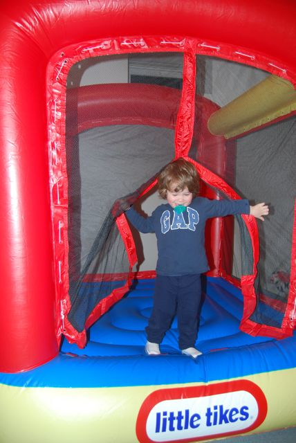 Adam in the bouncy house