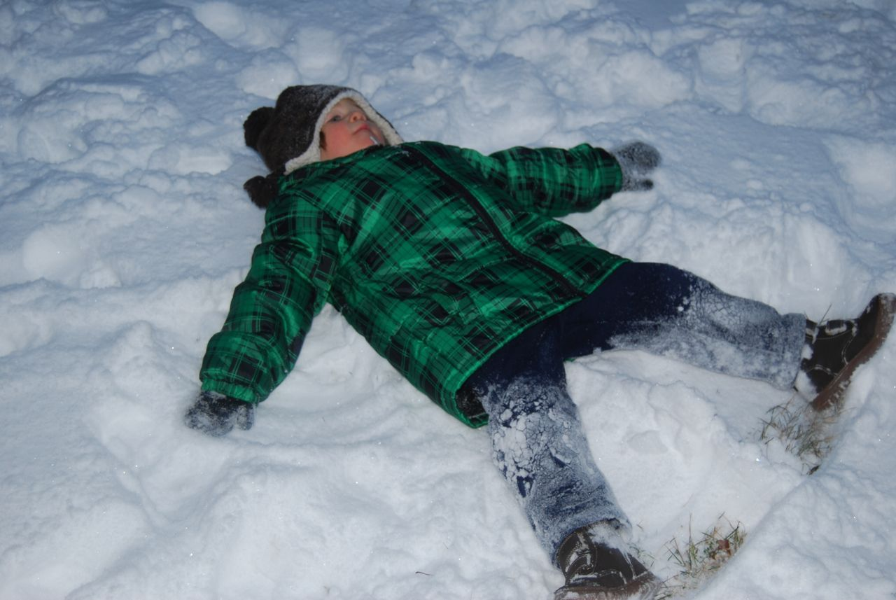 Adam making snow angels