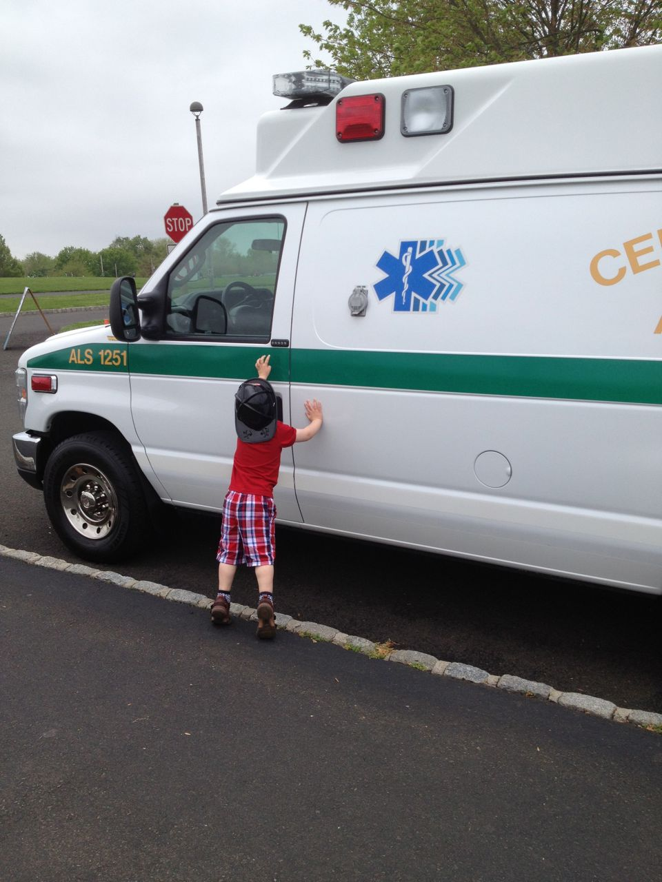 Adam tries the ambulance door