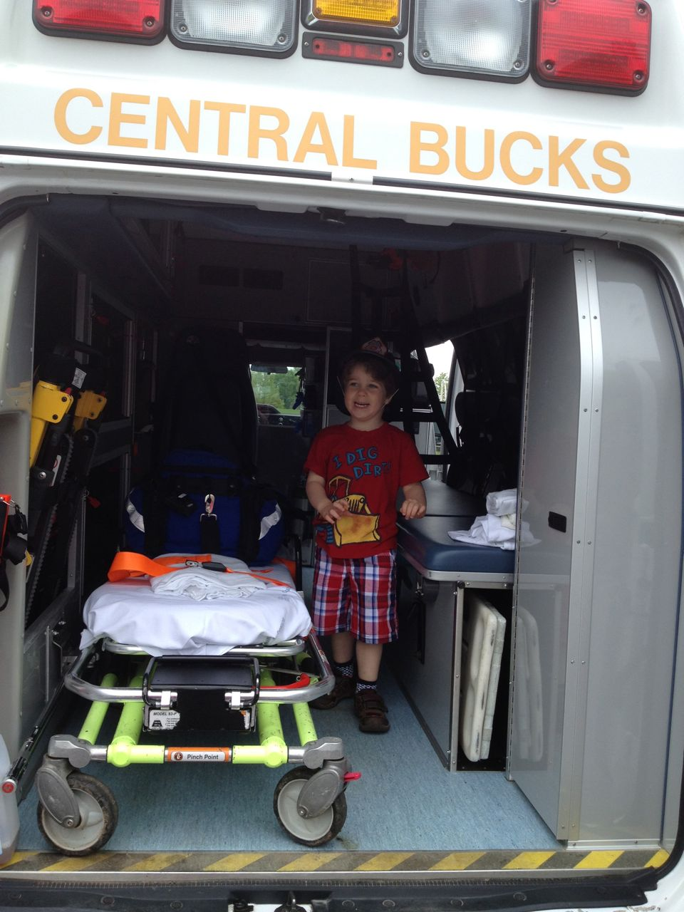 Adam in the back of the ambulance