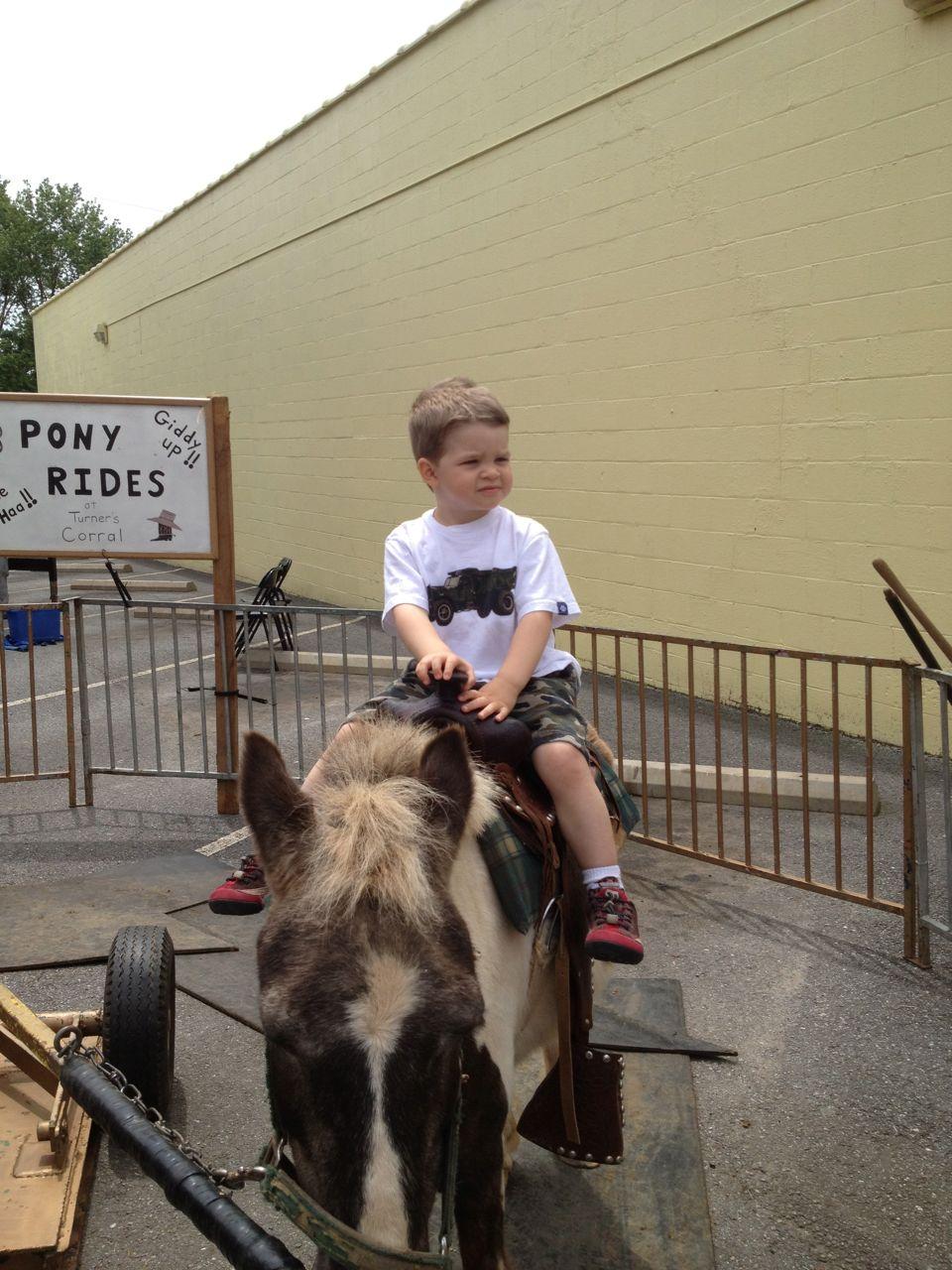 Alex rides a pony