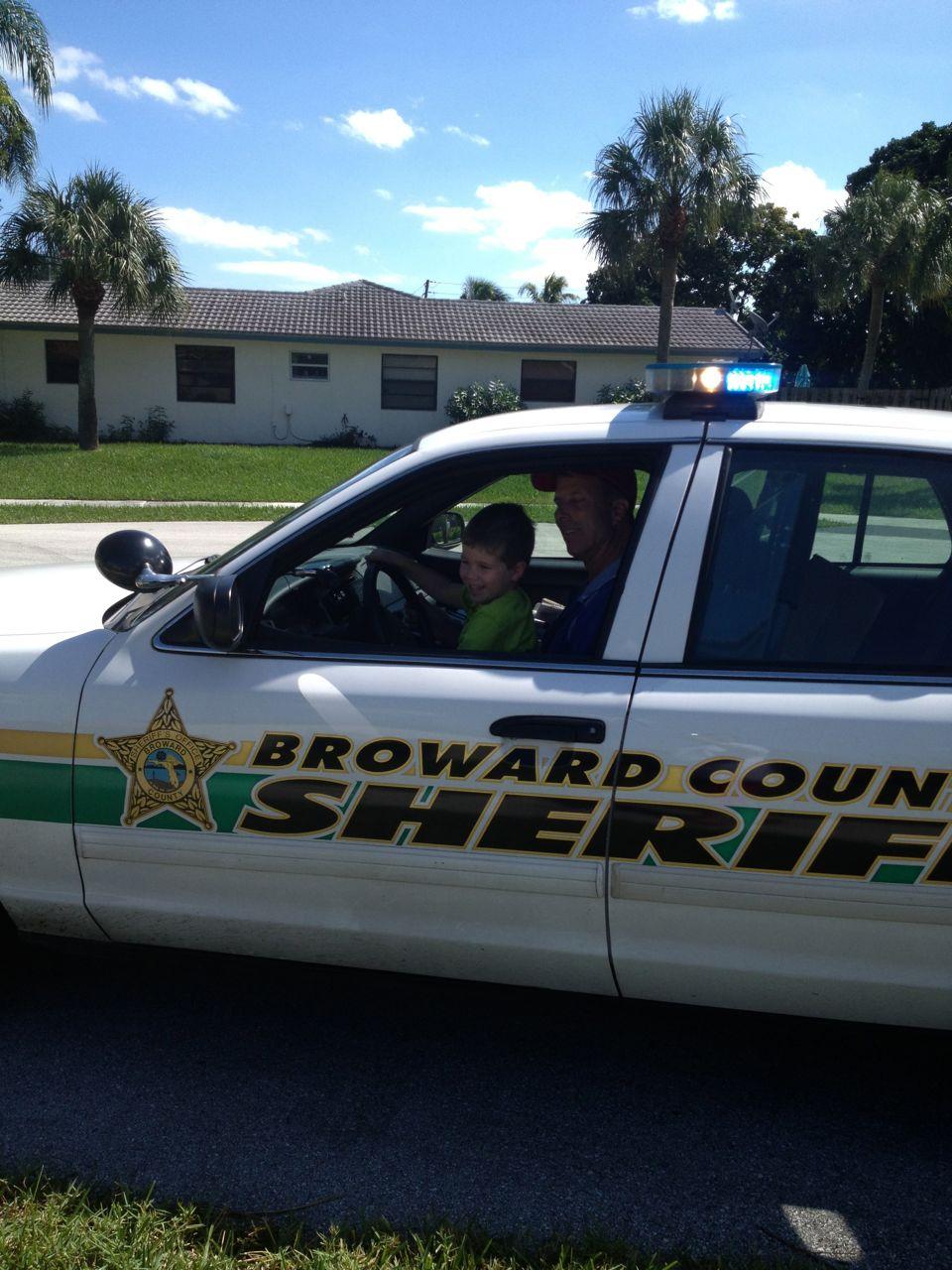 Adam in the police car