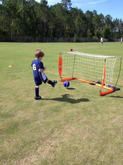 Alex kicks a goal