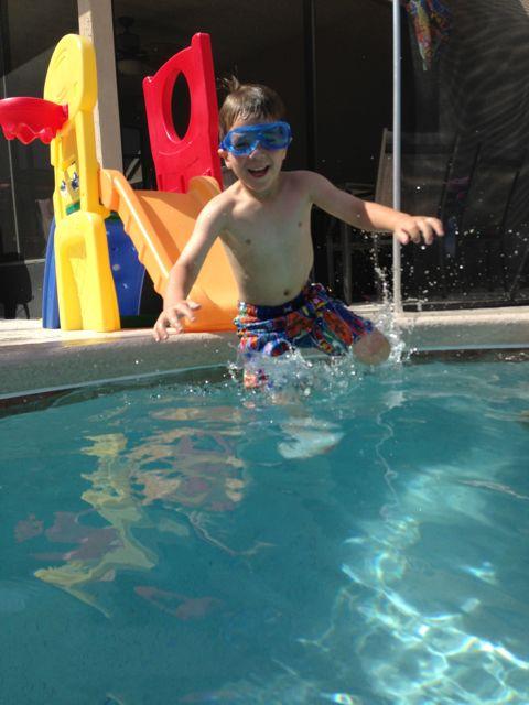 Adam slides into the pool