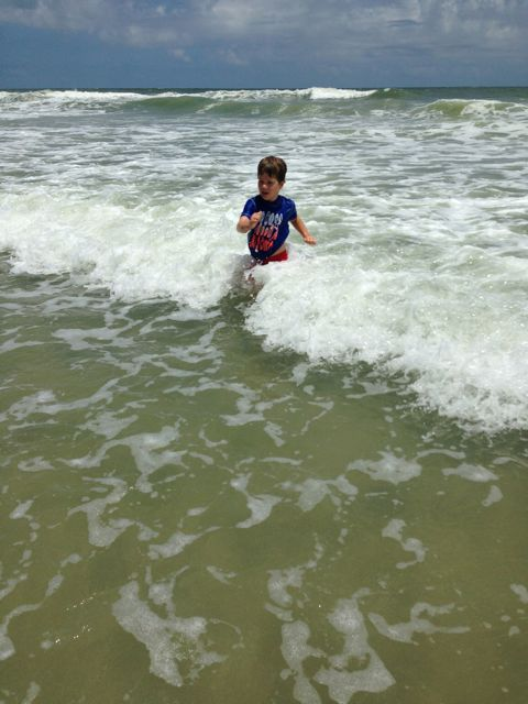 Adam in the surf