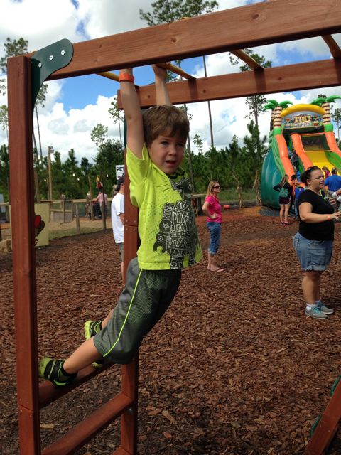 Adam on the monkey bars