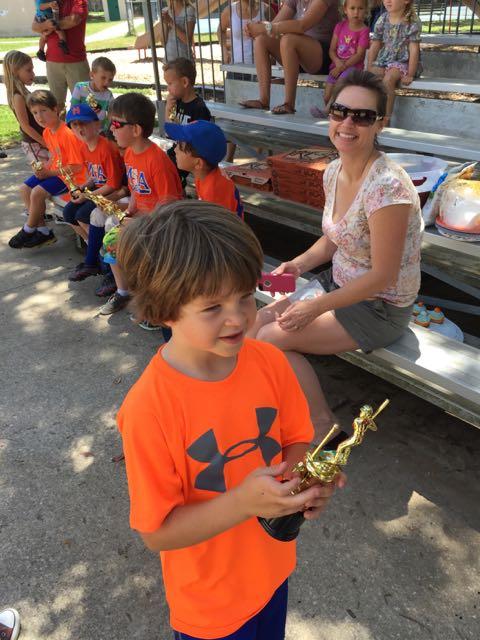 Alex accepts his trophy