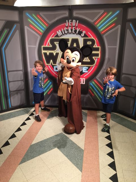 The boys with Jedi Mickey