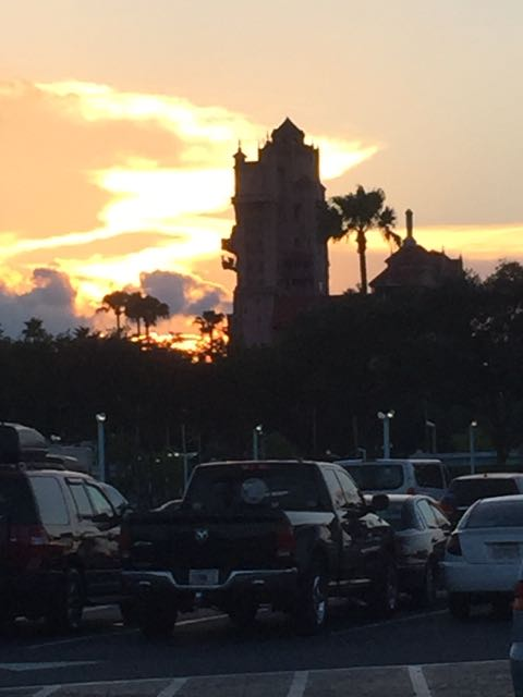 The sun sets behind the Tower of Terror