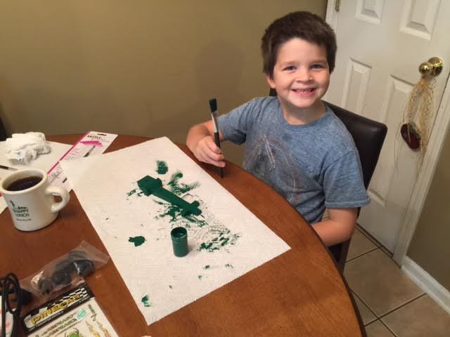 Alex paints his car